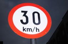 An Irish 30 kmh speed sign in the dark night sky.